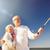 seniors with smartphone taking selfie on beach stock photo © dolgachov