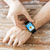 close up of hands with music player on smart watch stock photo © dolgachov
