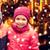 little girl hugging boy over snow and carousel stock photo © dolgachov