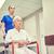 enfermera · altos · mujer · silla · de · ruedas · hospital · medicina - foto stock © dolgachov