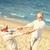 gelukkig · holding · handen · zomer · strand · familie - stockfoto © dolgachov