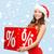 woman in santa helper hat with percent sign stock photo © dolgachov