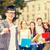 feliz · estudante · graduação · boné · livros - foto stock © dolgachov