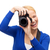 smiling woman taking picture with digital camera stock photo © dolgachov