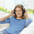 smiling young girl in headphones at home stock photo © dolgachov