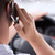 close up of man using smartphone while driving car stock photo © dolgachov