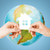 couple hands holding green house over earth globe stock photo © dolgachov