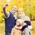 famiglia · figlio · di · padre · parco · fotocamera · digitale · donna · felice - foto d'archivio © dolgachov