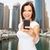 woman taking picture by smartphone over dubai city stock photo © dolgachov