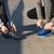 close up of couple tying shoelaces outdoors stock photo © dolgachov
