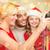 smiling family in santa helper hats taking picture stock photo © dolgachov