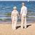 feliz · pareja · de · ancianos · tomados · de · las · manos · verano · playa · familia - foto stock © dolgachov