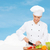 smiling female chef chopping vagetables stock photo © dolgachov