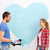 smiling couple painting big heart on wall stock photo © dolgachov