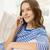 笑顔の女性 · 座って · ソファ · スマートフォン · 電話 · 幸せ - ストックフォト © dolgachov