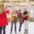 happy friends taking photo on skating rink stock photo © dolgachov