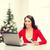 gülümseyen · kadın · kırmızı · elbise · dizüstü · bilgisayar · Noel · noel - stok fotoğraf © dolgachov
