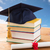 close up of books with diploma and mortarboard stock photo © dolgachov