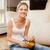 smiling teenage girl with remote control stock photo © dolgachov
