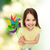 smiling child with colorful windmill toy stock photo © dolgachov