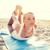 young woman making yoga exercises outdoors stock photo © dolgachov