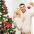 happy couple decorating christmas tree at home stock photo © dolgachov