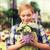 gelukkig · vrouw · bloemen · broeikas · mensen · tuinieren - stockfoto © dolgachov