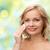 красивая · женщина · очистки · довольно · хлопка · улыбаясь - Сток-фото © dolgachov