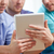 close up of happy friends with tablet pc at home stock photo © dolgachov