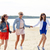 group of smiling women in sunglasses on beach stock photo © dolgachov