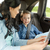 happy family with travel map driving in car stock photo © dolgachov