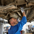 mechanic man with flashlight repairing car at shop stock photo © dolgachov