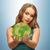 woman holding green globe on her hands stock photo © dolgachov