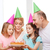 smiling family with two kids in hats with cake stock photo © dolgachov