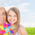 happy mother and little girl with pinwheel toy stock photo © dolgachov