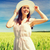 smiling young woman in straw hat on cereal field stock photo © dolgachov