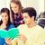 group of smiling students with notebooks stock photo © dolgachov