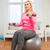smiling woman with dumbbells exercising at home stock photo © dolgachov