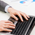 close up of businessman hands typing on laptop stock photo © dolgachov