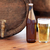 close up of old beer barrel glass and bottle stock photo © dolgachov