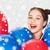 happy teenage girl with helium balloons over snow stock photo © dolgachov