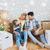 gelukkig · gezin · dozen · bewegende · nieuw · huis · hypotheek · mensen - stockfoto © dolgachov