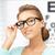 woman in eyeglasses with eye chart stock photo © dolgachov