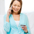 smiling woman with smartphone at home stock photo © dolgachov