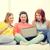 vriendinnen · sofa · laptop · ontspannen · samen · nacht - stockfoto © dolgachov