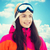happy young woman in ski goggles over blue sky stock photo © dolgachov