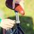 close up of man adjusting fixed gear bike saddle stock photo © dolgachov