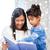 uczennica · nauczyciel · czytania · książki · klasy · kobieta - zdjęcia stock © dolgachov