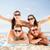 group of smiling people having fun on the beach stock photo © dolgachov