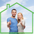 smiling couple showing thumbs up over green house stock photo © dolgachov